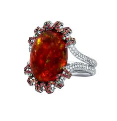 Red cabochon carat fire opal surrounded by 354 diamonds, 14 green tsavorite garnets and 179 orange-red sapphires. Micro-set diamond double band in white gold setting. Red Sapphire, Celebrity Jewelry, Opal Jewelry, Jewellery, October Birth Stone, Garnet, Fashion Jewelry, Jewelry Design, White Gold