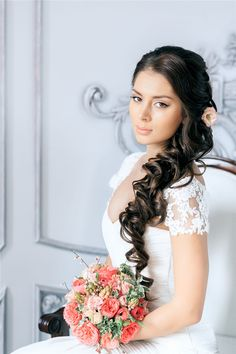 half up hairstyle for wedding with pink flower