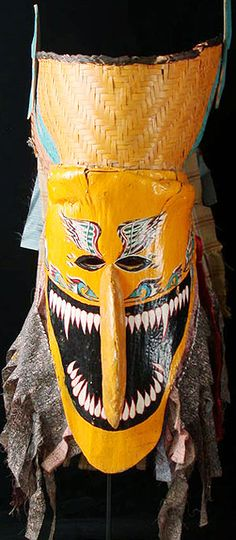 Thai Phi Ta mask    Dan Sai, Loe, Thailand    22 inches, painted palm frond, basket work, wood, cloth