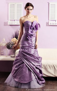 """Taylor Swift – """"Love Story""""  EGPP08 - A silk taffeta mermaid in smoky amethyst with asymmetrical pleated draping bodice.  Gently cascading into a tulle lower skirt.  Enhance with lace and organza floral motif. #wedding #evening #dresses #gowns #bridal #taffeta #mermaid #lune #lunewedding"""