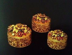 Gold engraved betel leaf and areca nut boxes with lids of floral design of precious stones.