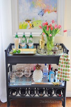 Ideas for Decorating Your Home with Flowers — 2 Ladies & A Chair - Pink tulips with this beautiful blush glassware from HomeGoods has the bar cart ready for a spring party! Sponsored by HomeGoods Diy Home Bar, Home Bar Decor, Bandeja Bar, Gold Bar Cart, Bar Cart Styling, Bar Furniture, Automotive Furniture, Automotive Decor, Furniture Online