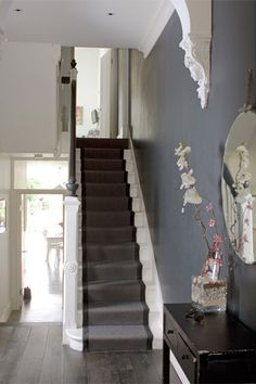 Grey and black stair runner with white and black bannister