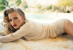 Lara Stone photographed by Norman Jean Roy. Vanity Fair, July 2011.