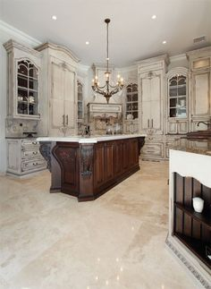 custom kitchen, old world finish---I really kind of like this...like Beauty and the Beast castle