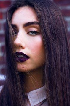 Deep purple lip, natural eye and thick brow. Love