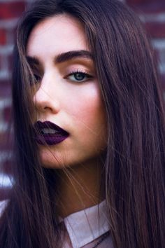 Deep purple lip, natural eye and thick brow. Love