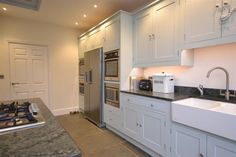 The kitchen with two double ovens, steam oven and island unit with breakfast bar