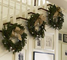 Wreaths up a stairway. Simple yet beautiful!