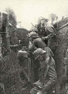 """ A German machine gun crew in a trench during the Battle of Tannenberg near the Masurian Lakes in East Prussia, August 1914. """