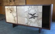 Interiors and homewares: Join the recycling revolution - Telegraph www.telegraph.co.uk Green property: An old Natural History Museum cabinet transformed by designer Dan Heath
