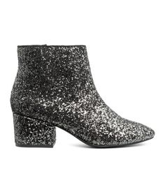 Silver-colored/glitter. Glittery ankle boots with a side zip, round toes, and covered heels. Fabric lining, fabric insoles, and rubber soles. Heel height 2