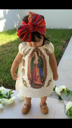 This is an infant wearing traditional attire to a baptism. Outfits as such are mostly seen in the Mexican culture. Her dress displays a picture of the Our Lady of Guadalupe. Baby Girl Fashion, Kids Fashion, Cute Kids, Cute Babies, Mexican Babies, Mexican Birthday, Mexican Party, Mexican Dresses, Mexican Baby Dress