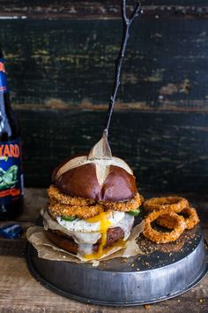Chili Style Sweet Potato Black Bean Burgers w/Baked Cheddar Beer Onion Rings + Fried Egg, a healthy mouthful of deliciousness from halfbakedharvest.com.