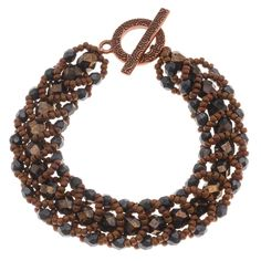 Shades of darkest charcoal and warm, rich coppery brown combine in this beautiful understated bracelet.