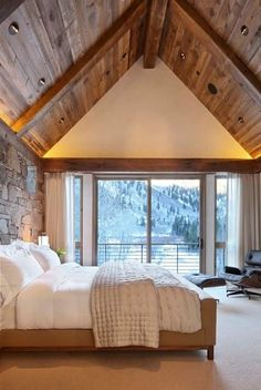 Bedroom with stone walls and wood ceilings