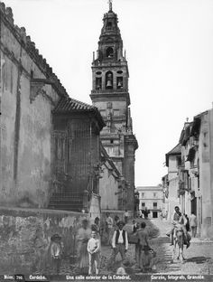 'Una calle exterior de la Catedral de Córdoba'. 1896 Andalusia Spain, Seville, Big Ben, Mount Rushmore, Places To Visit, Mountains, Building, Travel, Beautiful