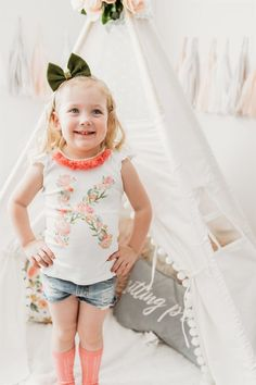 These monogram tees are a spring and summer must-have! With the sweet flutter sleeve, you won't go wrong on those warmer days. A beautiful floral monogram with tones of peach and pink are sure to make your little doll a standout wherever she goes!  These shirts have a fitted look so size up if you would like the room to grow. Cute Outfits For Kids, Cute Kids, Flutter Sleeve Top, Little Doll, White Tees, Kids Wear, Kids Fashion, Flower Girl Dresses, Peach
