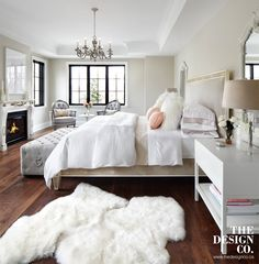 master bedroom, parisian chic, sheepskin rugs, tufted bench, white bedding, peach and gray, white bedside tables