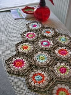 crochet ... I like the uniform colours in this and the way the main colour and the outer round of the the hexi  are the same but the centres are different... Very nice... Kerry