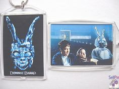 SellPin.com: Pins for Sale by Owner: This Donnie Darko key chain celebrates the 2001 cult classic. One side shows the film poster & the other an iconic scene from the film. It measures 2 x 3 inches (about the size of a credit card).Gretchen: Donnie Darko? What the hell kind of name is that? It
