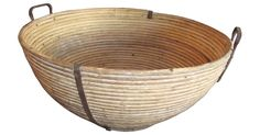 French rattan dough raising basket with hand wrought iron handles. It was found in the attic of a bistro where it had been stored unused for decades. Wear consistent with age and use.