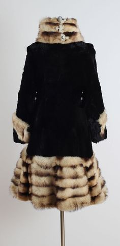 1920's coat made of soft sheared beaver fur and trimmed in Fitch fur, wide cuffed sleeves, tall wrapped collar, two button closure in front, acetate lining with interior pocket, made by Herman & Ben Marks Fur of Detroit (back view)