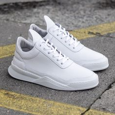 """""""Another look at the minimalistic Low Top Ghost White. A crisp trainer made with premium white tanned Italian full grain leather. Available online at…"""""""