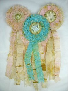 Tutorial: How To Make a Crepe Paper Rosette Prize Ribbon from http://arbutushunter.blogspot.com/2010/05/tutorial-how-to-make-crepe-paper.html