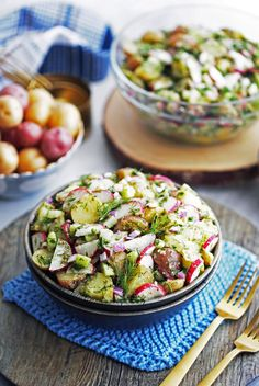 A wooden bowl full of Mustard Dill Potato Salad with more salad in a glass bowl, and small bowl of baby potatoes behind it.