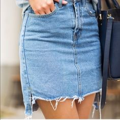 Uneven hem denim skirt Highwaisted uneven hem denim skirt. So cute accept it is too small on me. :( ACCEPTING OFFERS Urban Outfitters Skirts Mini