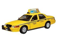 This Ford Crown Victoria Taxi Diecast Model Car is Yellow and features working wheels and also opening bonnet with engine, doors. It is made by Motor Max and is 1:18 scale (approx. 26cm / 10.2in long).  ...