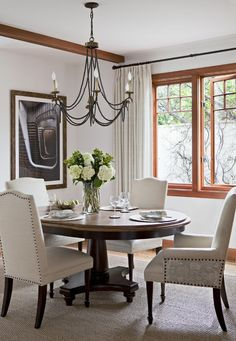 i like this style table but chairs are a bit much  Small Round Dining Tables for Big Style Statement