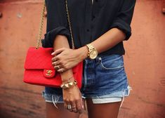 Sincerely Jules. Black shirt, denim shorts, red Chanel bag, gold jewellery