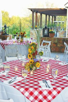 Half size red check table cloth over white linens