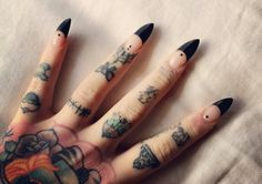 Great finger tattoos and black feel manicue stilettos love this