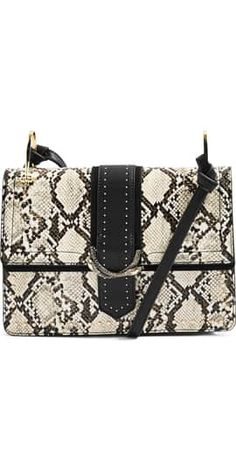 1d699463e4 Faux snakeskin front and solid back bring chic sophistication to this  must-have shoulder bag