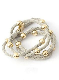 Boho-chic braided suede wrap bracelet with gold bead details and gold magnetic clasp by Despi Swimwear, $72.00