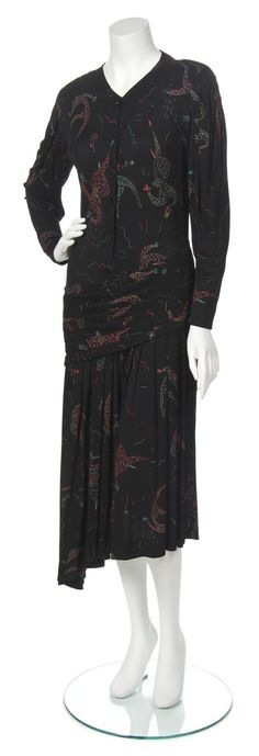 "Jean Muir Black Print Jersey Dress. ""long sleeves, button front closure with asymetrically draped panel to the hips and a knife pleated skirt . Labeled: Jean Muir London)""  Lot# 124---lot image"