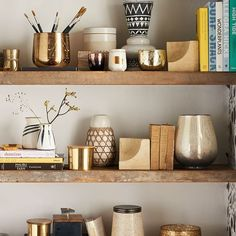 Gold accents on a shelf | Shop Anthropologie Home