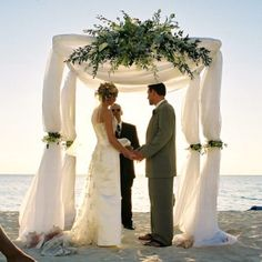 I like the the idea of an outdoor wedding and this white arch would make it look better.