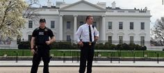 The White House has been locked down amid fears a suspicious package was hurled over the fence.