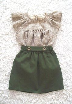 Light print blouse and green skirt.