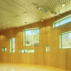 Children's daycare center in Espoo, Finland, clad inside and out in strips of timber.