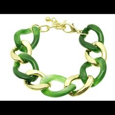 """CHUNKY LINK GOLD LINK BRACELET Cute and trendy gold tone links with marbeled green links. The bracelet is plastic resin, lightweight. Fits wrist up 7.5"""" with extender. Brand new from our boutique. Jewelry Bracelets"""