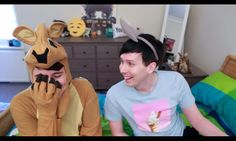 maybe it's just me but i love phils little emoji pillow that sits on his dressed idk it's so cute