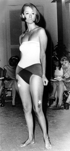 Rudi Gernreich's one-piece swimsuit is shown in New York City in 1966. The stick-on pasties shaped like stars and flowers are part of the swimwear.