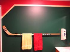 a hockey stick makes a unique towel rack... Extreme Interior Design: Sports Meet Bathroom Decor from Bathroom Bliss by Rotator Rod