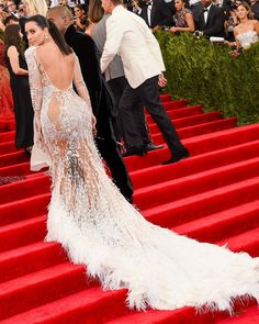 Kim Kardashian's see-through dress by Emilio Pucci is stunning from the front, but the fringe feathers trailing the dress makes the back even more eye-catching. She wore this look on the 2015 Met Ball red carpet.