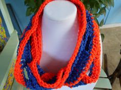 This scarf is 3 1/2 by 32 inches and is made with acrylic yarn Hand was and drape to dry.